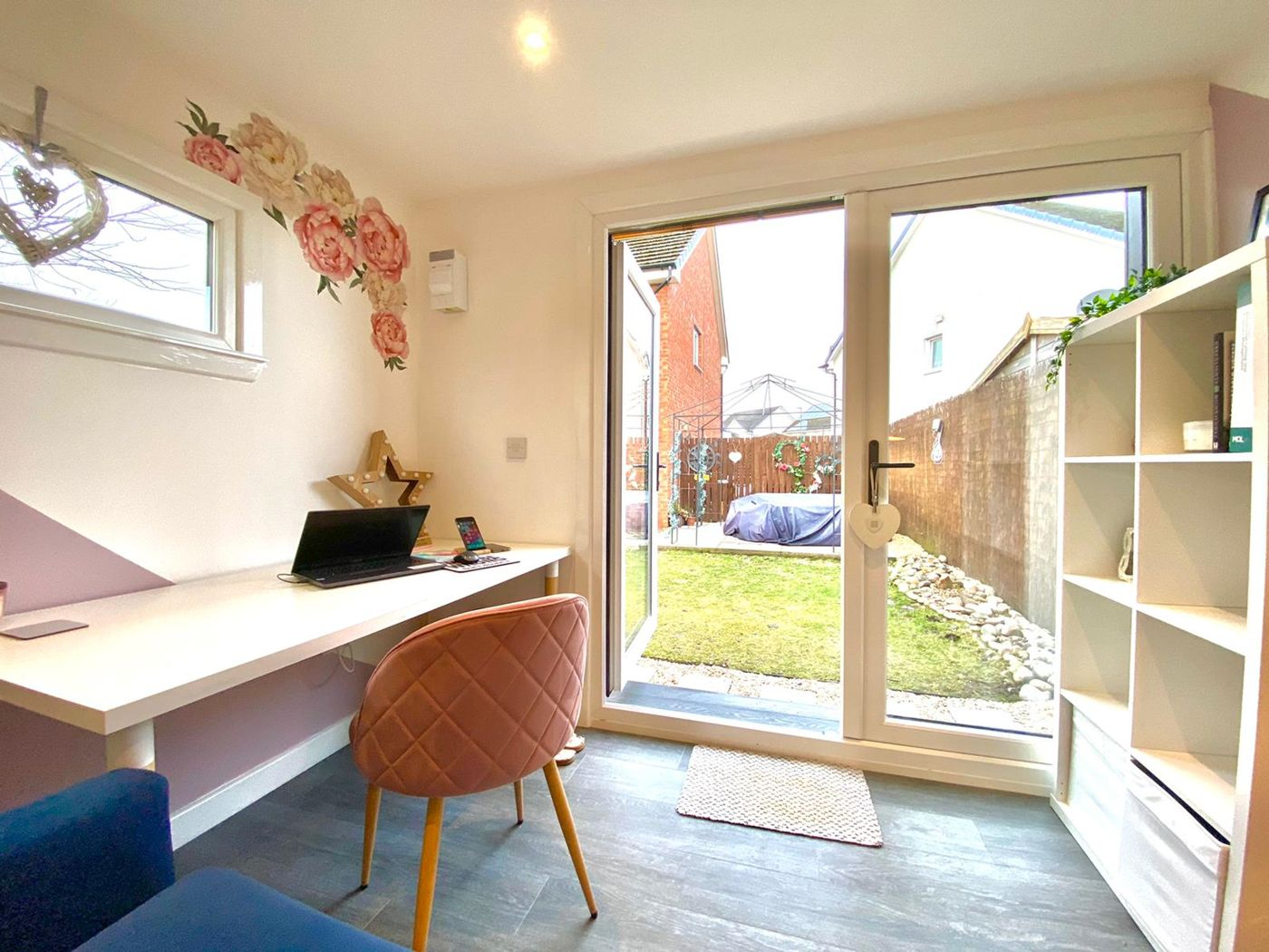 garden office interior with white french patio doors desk and chair